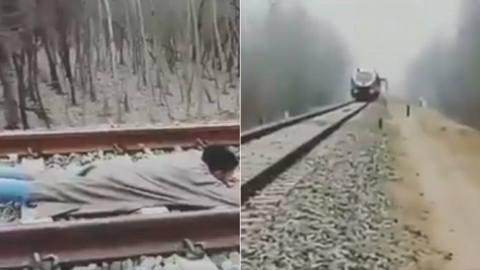 Watch Kashmiri man attempts life-threatening rail stunt, Twitter calls it stupidity