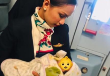 Air hostess breastfeeds hungry baby onboard flight as mother runs out of formula milk, wins accolades