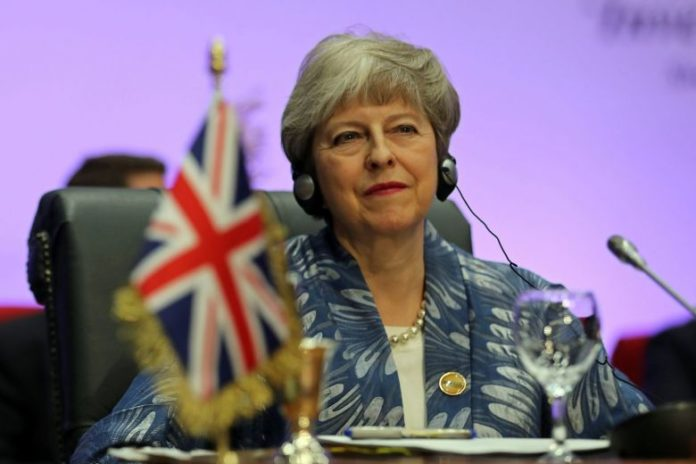 British PM Theresa May signals she is ready to fight on